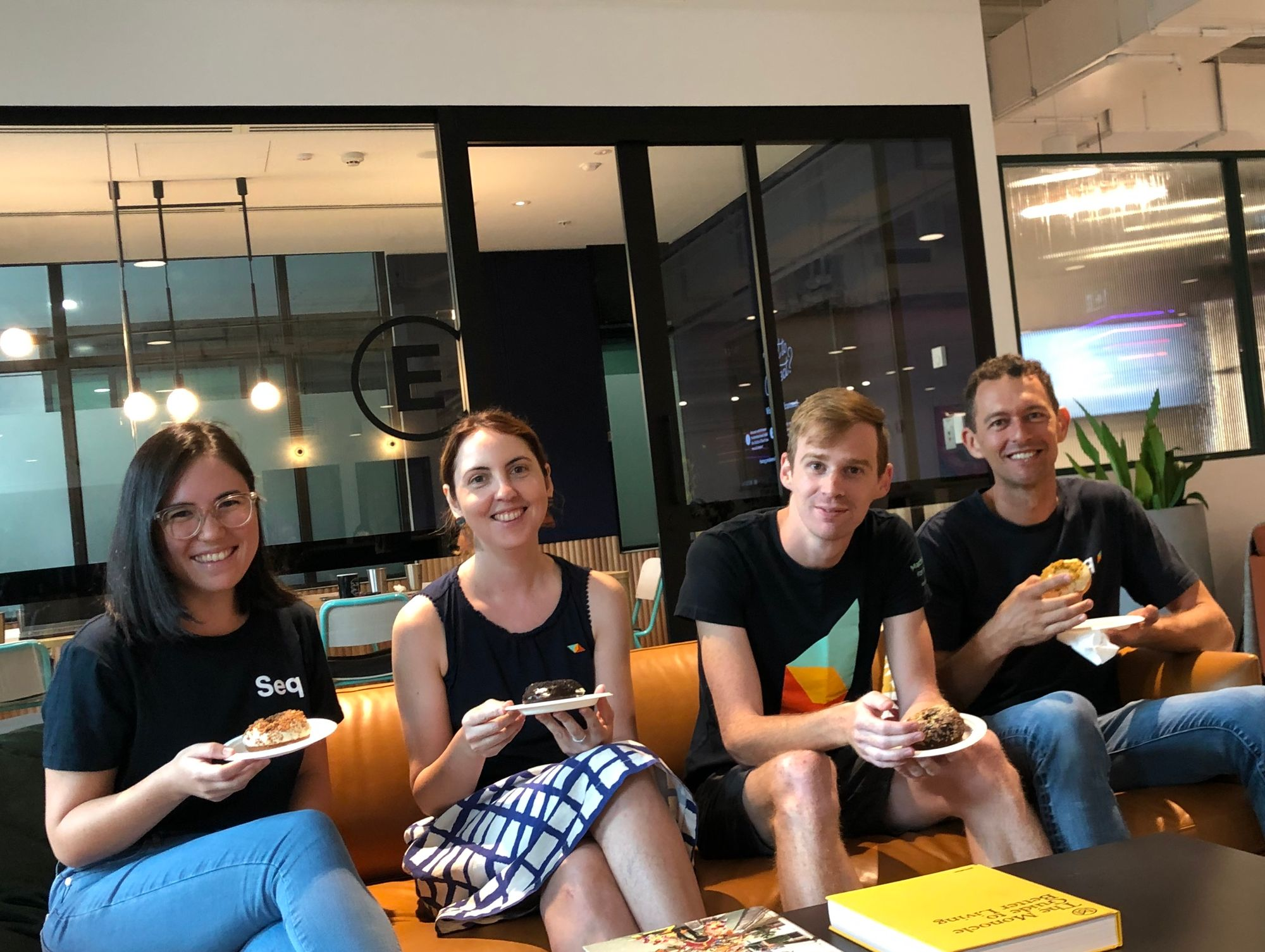 Pictured: The Datalust team – Larene, Susan, Ashley, Nick sitting on a couch eating donuts